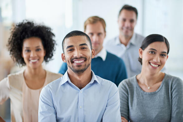 diverse employees looking at camera