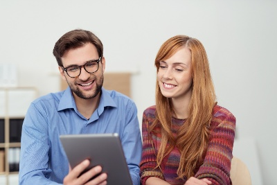 two employees looking at ipad