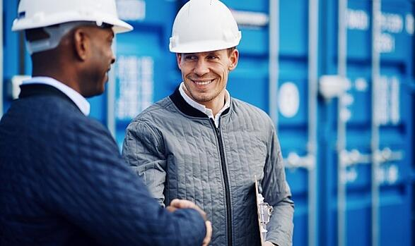 two men shaking hands on jobsite