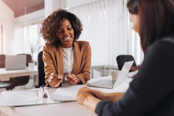 woman in blazer talking to customer