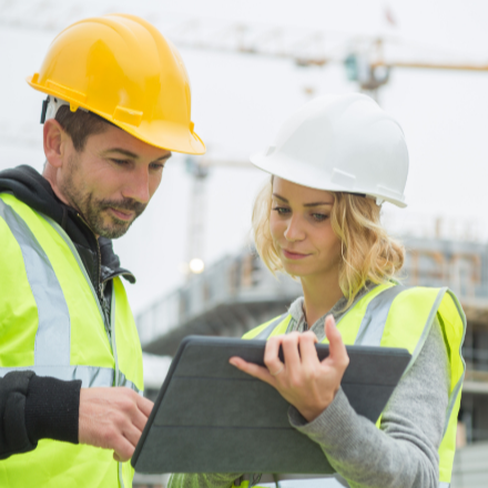 Construction workers using tablet
